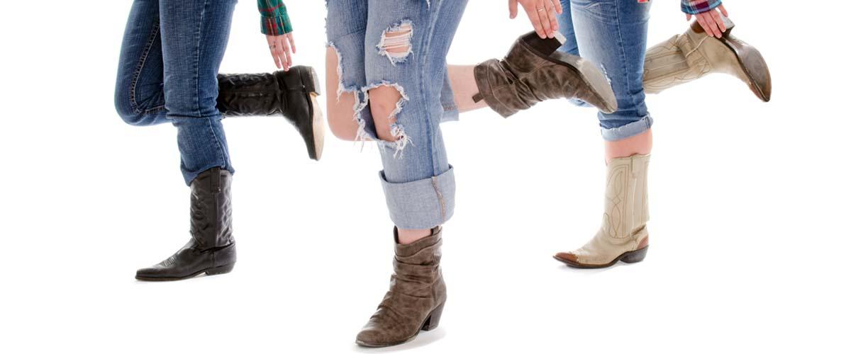Legs of Three Women in Line Dance Class
